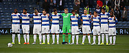 QPR team during the one minutes silence to remember the victims of the Shoreham air show disaster during the Capital One Cup match between Queens Park Rangers and Carlisle United at the Loftus Road Stadium, London, England on 25 August 2015. Photo by Matthew Redman.