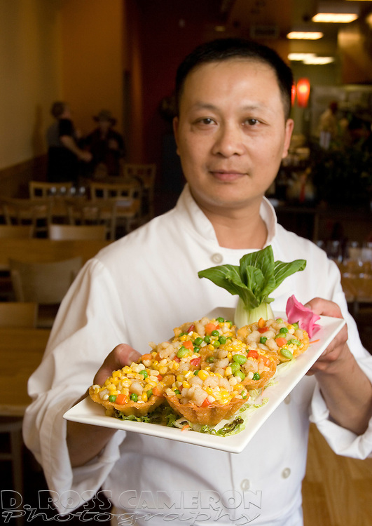 Chef Yu Cai Zhang holds the Marty's Favorite entree at Lin Jia Asian Kitchen in Oakland, Calif., Tuesday, Aug. 30, 2011. (Photo by D. Ross Cameron)