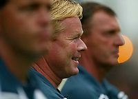 Photograph: Scott Heavey.<br />Nottingham Forest V Ajax Amsterdam.<br />23/07/2003.<br />Ajax boss Ronald Koeman watches his side warm up.