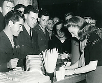 1944 Joan Leslie signing autographs at the Hollywood Canteen