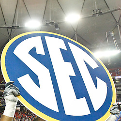 Dec 3, 2011; Atlanta, GA, USA; LSU Tigers defensive tackle Josh Downs (77) holds up a SEC sign following a win over the Georgia Bulldogs in the 2011 SEC championship game at the Georgia Dome.  Mandatory Credit: Derick E. Hingle-US PRESSWIRE