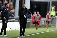 Shaun Derry, the Cambridge United manager points as he instructs his players from the touchline. The Emirates FA Cup, 2nd round match, Newport County v Cambridge United at Rodney Parade in Newport, South Wales on Sunday 3rd December 2017.<br /> pic by Andrew Orchard,  Andrew Orchard sports photography.
