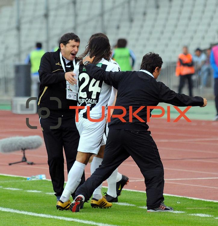 Altayspor's coach Guvenc KURTAR (L) during their Turkish soccer Play Off final match Altayspor between Konyaspor at Ataturk Olympic Stadium in Istanbul Turkey on Sunday, 23 May 2010. Photo by TURKPIX