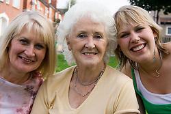 Three generations of women; smiling,