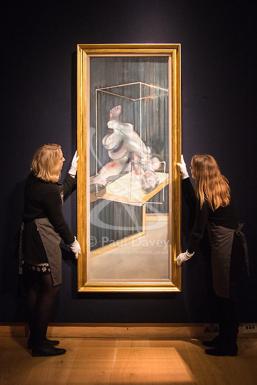 Christies, St James, London, February 5th 2016. Gallery technicians hang Francis Bacon's  Two Figures, with an estimated value of £10-20 million at the 20th Century Art Sale Preview. ///FOR LICENCING CONTACT: paul@pauldaveycreative.co.uk TEL:+44 (0) 7966 016 296 or +44 (0) 20 8969 6875. ©2015 Paul R Davey. All rights reserved.