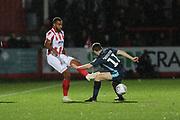 Tyrone Barnett and Jordan Rossiter   during the EFL Sky Bet League 2 match between Cheltenham Town and Bury at LCI Rail Stadium, Cheltenham, England on 5 March 2019.