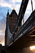 Sunlight radiates from the seting sun under Tower Bridge, London.
