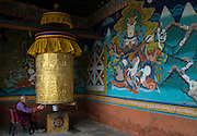 Man spinning prayer wheel at Pumakha Dzong, Bhutan