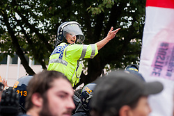 """Rotherham England<br /> 13 September 2014 <br /> A mounted police officer directs EDL members and supporters away from a potential trouble spot during the EDLs """"Justice for the Rotherham 1400"""" march described by an EDL Facebook Page as """"a protest against the Pakistani Muslim grooming gangs"""" on Saturday Afternoon <br /> <br /> <br /> Image © Paul David Drabble <br /> www.pauldaviddrabble.co.uk"""