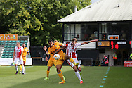 Joss Labadie of Newport county (l) holds off Harry Pell of Cheltenham Town (r).  EFL Skybet football league two match, Newport county v Cheltenham Town at Rodney Parade in Newport, South Wales on Saturday 10th September 2016.<br /> pic by Andrew Orchard, Andrew Orchard sports photography.