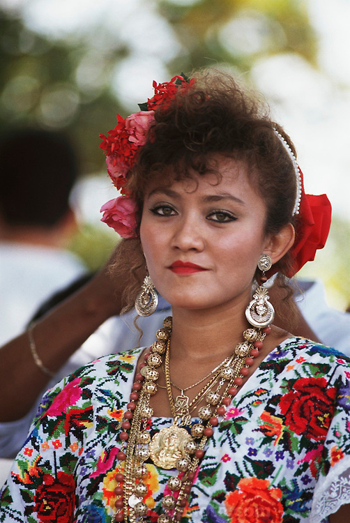 A young woman wearing traditional Mayan clothing, waiting for president Salinas to arrive in Kopoma, Yucatan, Mexico.