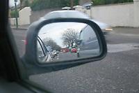 Traffic reflected in car mirror, Dublin, Ireland