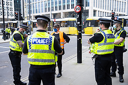 CORRECTION - the fine issued is £10,000 NOT £2,000 © Licensed to London News Pictures. 07/03/2021. Manchester, UK. Police issue a £10,000 fixed penalty notice to event organiser , Mental Health Nurse KAREN REISSMANN (61) . Police break up what they say is an illegal gathering under Coronavirus legislation as nurses and their supporters attempt to protest in St Peter's Square in Manchester City Centre over the British Government proposing a one percent pay increase to nurses' salaries . Photo credit: Joel Goodman/LNP