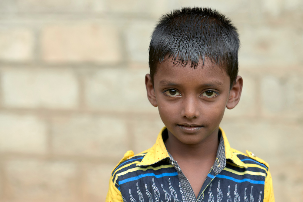 A boy in Parantan, Kilinochchi, Sri Lanka. His mother participates in a church-sponsored women's group, many of whose members are widows, their husbands killed during the country's brutal civil war.
