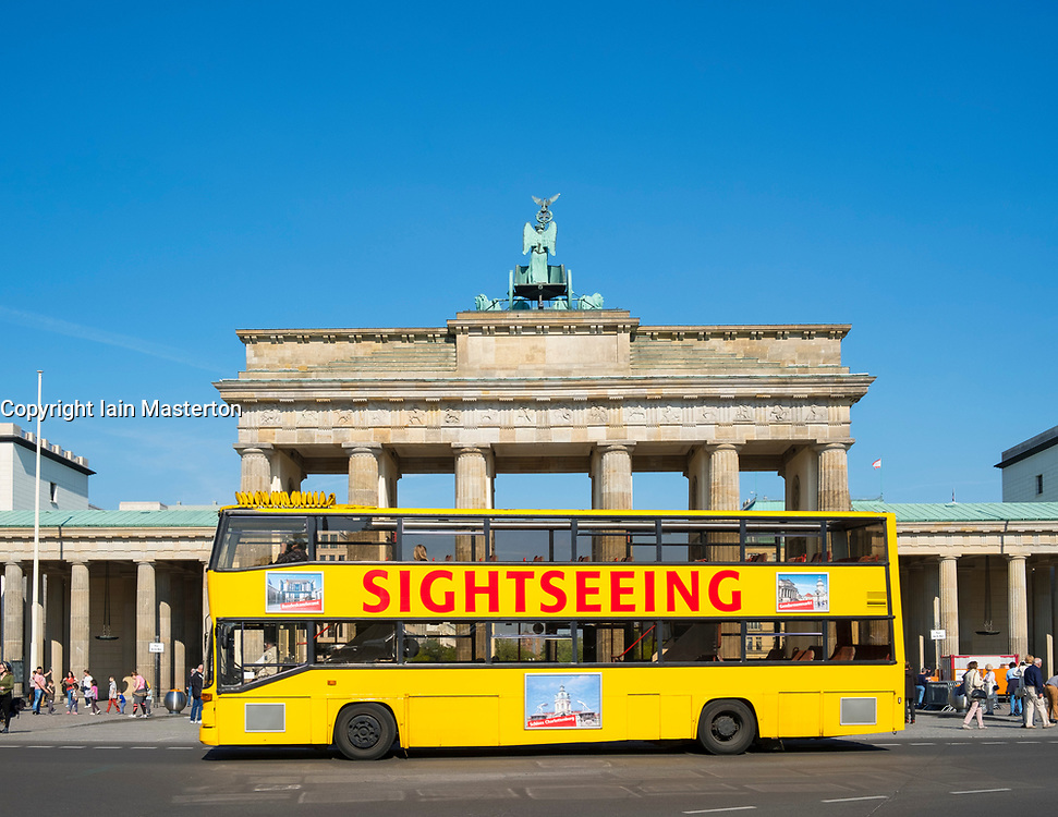 Tourist sightseeing tour bus in front of Brandenburg Gate in Berlin, Germany