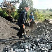 Charcoal burners working in the village of Viscri, Saxon Transylvania, Romania.