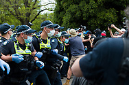 Police lock arms as the move on protesters during the Melbourne Freedom Rally at The Shrine. Premier Daniel Andrews promises 'significant' easing of Stage 4 restrictions this weekend. This comes as only one new case of Coronavirus was unearthed over the past 24 hour and no deaths. (Photo by Dave Hewison/Speed Media)