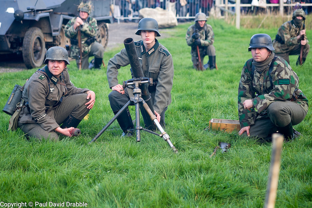 German 81mm mortar crew wait for the start of a battle reenactment on pickering showground during the 1940's Wartime weekend.<br /> <br /> 17/18 October 2015<br />  Image © Paul David Drabble <br />  www.pauldaviddrabble.co.uk