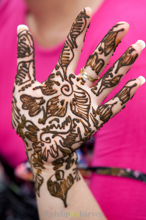 A woman's hand tatooed in henna, dye from a plant, in the Djemaa el Fna in the medina of Marrakech in Morocco