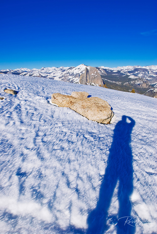 Silhouette of skier and Half Dome from the summit of Sentinel Dome, Yosemite National Park, California