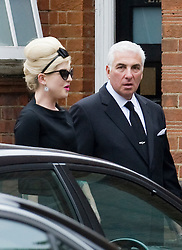 © licensed to London News Pictures.  26/07/2011. London, UK. Kelly Osbourne and Mitch Winehouse (Father of Amy Winehouse) arriving at the funeral service of singer Amy Winehouse at Gouldes green Crematorium in Goulders Green North London today (26/07/2011). In line with Jewish tradition, the private service took place as soon as possible after the singer's death. Photo credit Ben Cawthra/LNP