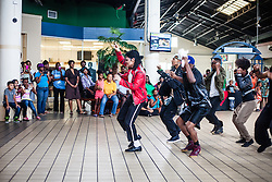 """Tribute artists and dancers from """"Invicible"""" perform for an audience at Tutu Park Mall.  Dancers of """"Invincible"""", a Michael Jackson tribute, will perform at Reichhold Center for the Arts Saturday at 7pm.  Tutu Park Mall.  1 November 2013.  © Aisha-Zakiya Boyd"""