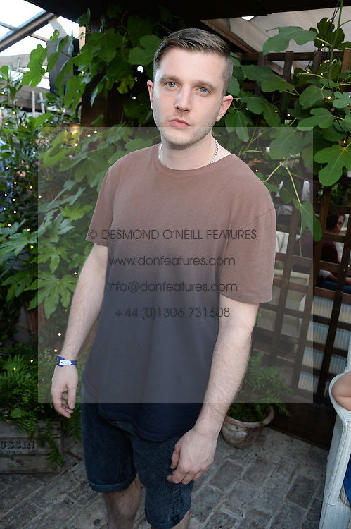 PLAN B (Ben Drew) attending the Warner Bros. & Esquire Summer Party held at Shoreditch House, Ebor Street, London E1 on 18th July 2013.