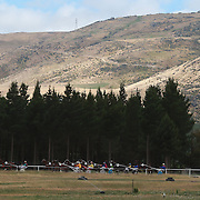 The surrounding hillsides provide a stunning backdrop to the harness racing during the Roxburgh Trotting Club Summer Festival Races, Roxburgh, Otago, New Zealand. 5th January 2012