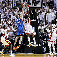 21 June 2012: Miami Heat center Ronny Turiaf (21) grabs a rebound over Oklahoma City Thunder center Cole Aldrich (45) during the Miami Heat 121-106 victory over the Oklahoma City Thunder, in Game 5 of the 2012 NBA Finals, at the AmericanAirlinesArena, Miami, Florida, USA. The Miami Heat wins the series 4-1.