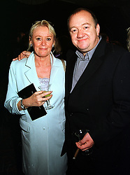 MR & MRS MEL SMITH he is the comedian at a party in London on 22nd September 1999.MWR 69
