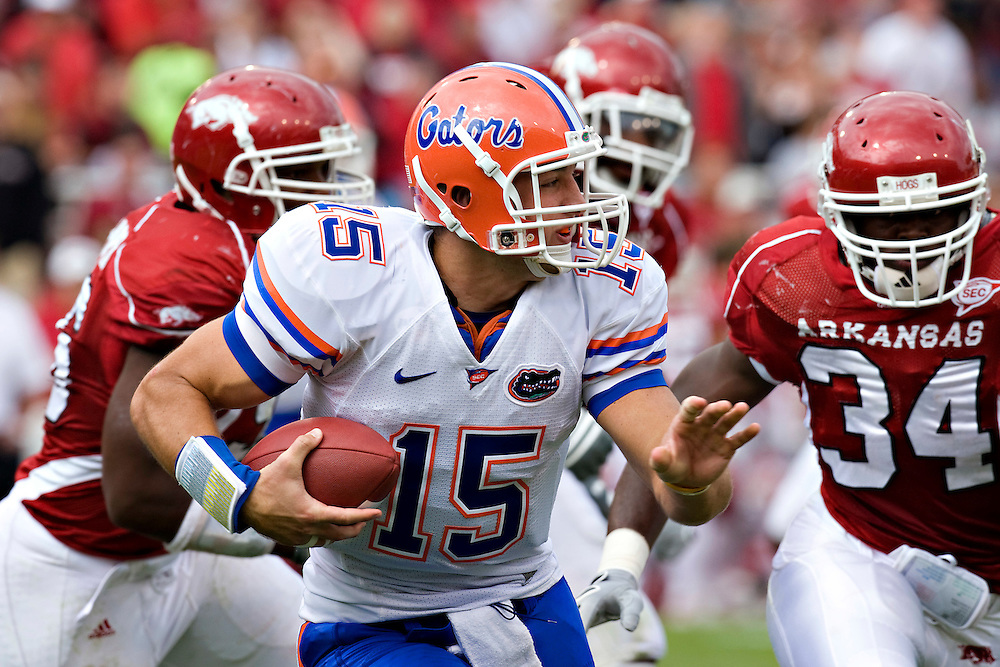 FAYETTEVILLE, AR - OCTOBER 4:   Tim Tebow #15 of the Florida Gators runs with the ball against the Arkansas Razorbacks at Donald W. Reynolds Stadium on October 4, 2008 in Fayetteville, Arkansas.  The Gators defeated the Razorbacks 38 to 7.  (Photo by Wesley Hitt/Getty Images) *** Local Caption *** Tim Tebow