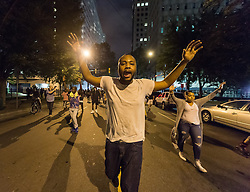 September 22, 2016 - Charlotte, North Carolina, United States of America - September 22, 2016 - Charlotte, NC, USA - A protestor marches during a third day of protests in Charlotte, North Carolina on Thursday, Sept. 22, 2016. This is the third day of protests that erupted after a police officer's fatal shooting of an African-American man Tuesday afternoon and the first full day of a declared State of Emergency by the governor. (Credit Image: © Sean Meyers via ZUMA Wire)