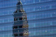 The King Street Station is reflected in the Vulcan building in Seattle.  (Ellen M. Banner / The Seattle Times)