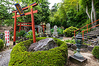 """Shinto Shrine at Goshoji Temple  -Goshoji - Midway up a small hill facing the Seto Inland Sea is Goshoji Temple, the 78th sacred spot along the Shikoku Henro pilgrimage. It is said that Kobo Daishi paid a visit to Goshoji Temple in 807, where he made a vow to ward off evil, and built a statue there. Even today Goshoji is famous as the temple """"where Kobo Daishi wards off evil"""". During the Kamakura period, Ippen Shonin, the founder of the Jishu sect, visited Goshoji Temple and propagated the Nenbutsu Odori, a type of Buddhist incantation with dance. As a result, Goshoji Temple is the only temple belonging to the Jishu sect on the Shikoku Henro pilgrimage. As the majority of sacred spots on the pilgrimage are associated with the Shingon sect of Buddhism, the fact that Goshoji Temple is a place of worship for both the Shingon sect and the Jishu sect makes it very unique."""