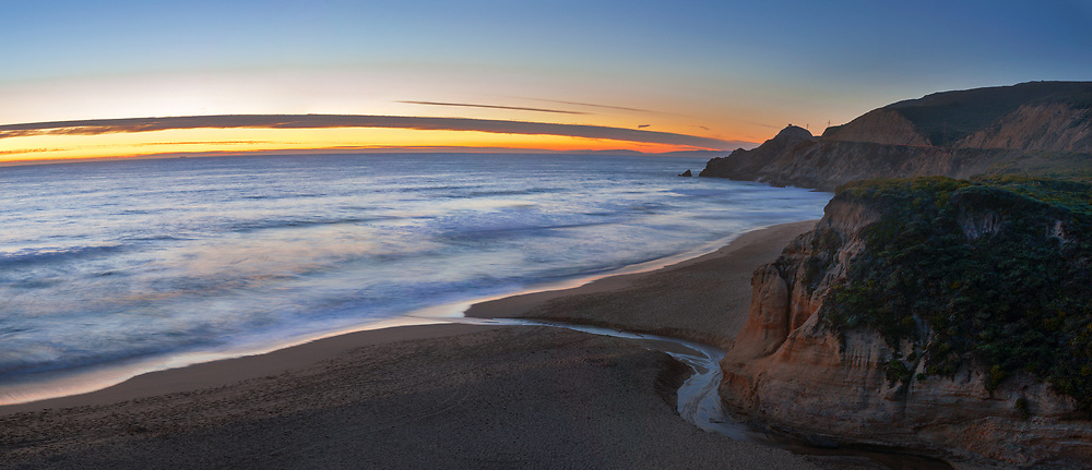 Montara Beach and Devils Slide are seen at sunset from the bluffs overlooking the coastline. Montara, CA