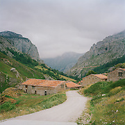 A lanes winding down to a farm in the countryside of the Asturias, Spain