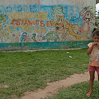 A Yanayacu Indian girl stands outside her school in San Juan de Yanayacu village in Peru's Amazon Jungle.