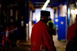 A Chelsea Pensioner peers through a side entrance to get a look of the pitch prior to kick off - Mandatory by-line: Ryan Hiscott/JMP - 10/12/2019 - FOOTBALL - Stamford Bridge - London, England - Chelsea v Lille - UEFA Champions League group stage