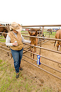 Proud owner with blue ribbon for mule colt at Montana Mule Days, Montana