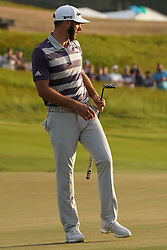 June 16, 2018 - Southampton, NY, USA - Dustin Johnson reaches to a missed putt on the 18th green during the third round of the 2018 U.S. Open at Shinnecock Hills Country Club in Southampton, N.Y., on Saturday, June 16, 2018. (Credit Image: © Brian Ciancio/TNS via ZUMA Wire)