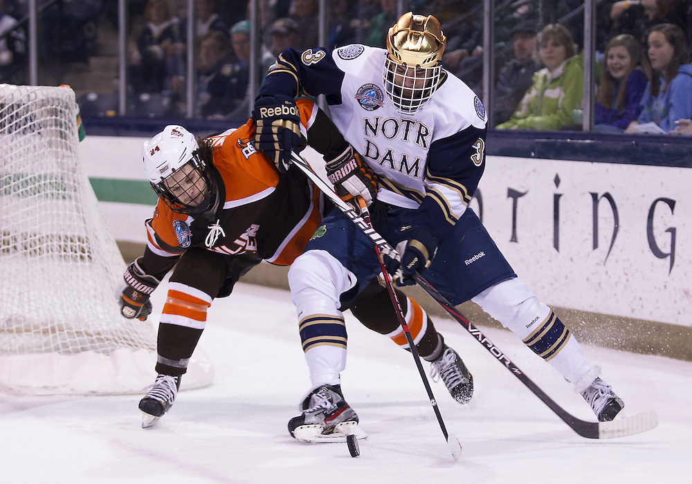 March 15, 2013:  Notre Dame defenseman Shayne Taker (3) and Bowling Green forward Brett Mohler (24) battle for the puck during NCAA Hockey game action between the Notre Dame Fighting Irish and the Bowling Green Falcons at Compton Family Ice Arena in South Bend, Indiana.  Notre Dame defeated Bowling Green 1-0 in overtime.