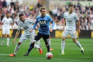 Christian Eriksen of Tottenham © goes past Angel Rangel of Swansea city (l). Barclays premier league match, Swansea city v Tottenham Hotspur at the Liberty Stadium in Swansea, South Wales on Sunday 4th October 2015.<br /> pic by  Andrew Orchard, Andrew Orchard sports photography.