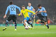 Brazil forward Neymar Jr (10) pulls the shorts of Uruguay defender Bruno Mendez (3) during the Friendly International match between Brazil and Uruguay at the Emirates Stadium, London, England on 16 November 2018.