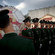 Miliary police practice marching in the Workers' Stadium in Beijing, which is getting ready to host the 2008 Olympics.