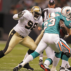 2008 August 28: New Orleans Saints defensive tackle Sedrick Ellis (98) goes in for the tackle on Miami Dolphins running back Ronnie Brown (23) of the Miami Dolphins during their game at the Louisiana Superdome in New Orleans, LA.