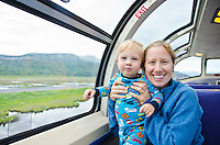 Portrait of mother and toddler son riding the Alaskan Railroad in route to Seward, Alaska.