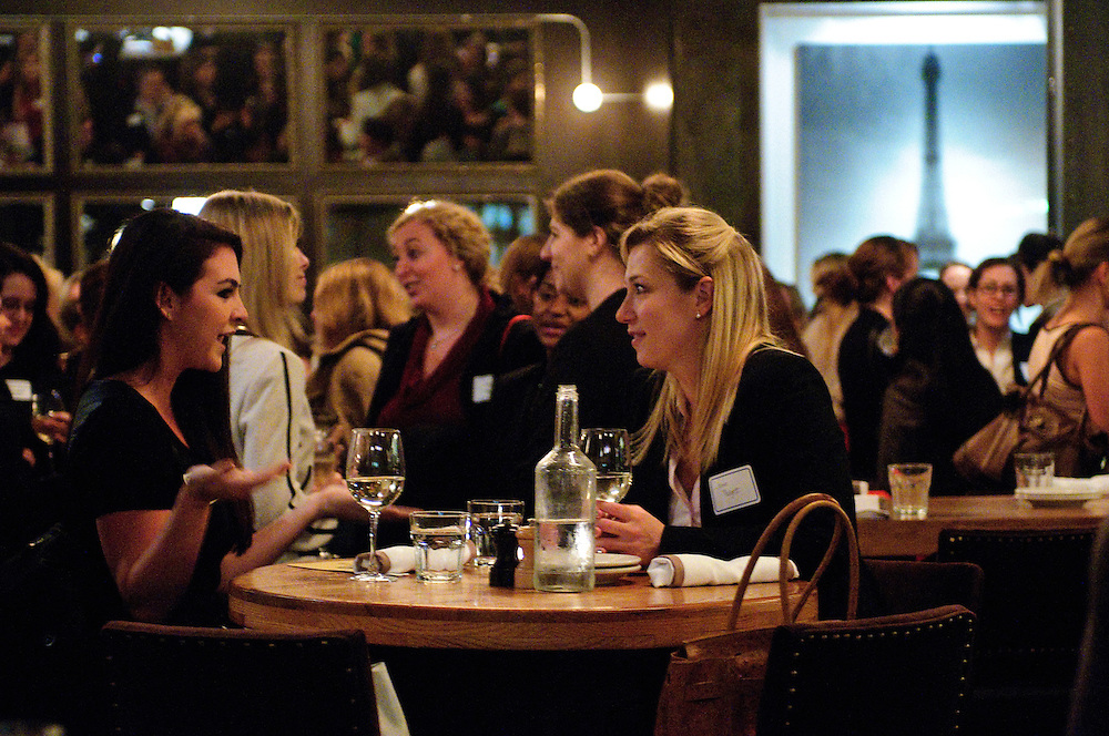 Notre Dame law graduate Kristina Cavallarro (foreground left) chats with Jaime Padgett of Levin Riback Law Group, P.C. (foreground right) during a Joint New Members, New Lawyers, and Mentor/Mentee Reception hosted by The Women's Bar Association of Illinois (WBAI) at Paris Club in Chicago's River North neighborhood on Monday, October 22nd. © 2012 Brian J. Morowczynski ViaPhotos