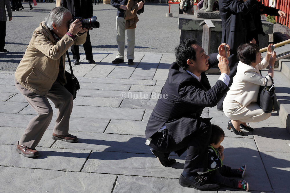 Asian people making pictures at the Tsurugaoka Hachiman shrine in Kamakura Japan