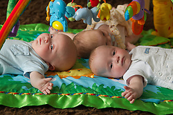 Babies on play mat baby gym.