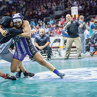 Shiprock Chieftain Princess Athsisi, left, fights a takedown attempt by Miyamura Patriot Nancy Rodriguez in the girls 160-pound glass first place match during the 2018 New Mexico High School Wrestling Championship at the Santa Ana Star Center in Rio Rancho Saturday.